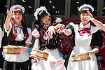 Maid cafe waitresses sprinkle water during the ''Uchimizukko Big Gathering Festival'' in Akihabara electric district of Tokyo, Japan on August 23, 2015. About 21 groups from Akihabara including maid cafes' waitresses and cosplayers attended the event, which included for the first time an official mascot character ''2C Chan.'' This year is the 12th anniversary of the event which began as a way to reduce dust and cool pavements in the Akihabara area. Uchimizukko is a Japanese summer tradition. (Photo by Rodrigo Reyes Marin/AFLO)