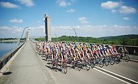 peloton starts the race on top of the Lac de l'Eau d'Heure weir<br /> <br /> 2014 Belgium Tour<br /> stage 4: Lacs de l'Eau d'Heure - Lacs de l'Eau d'Heure (178km)