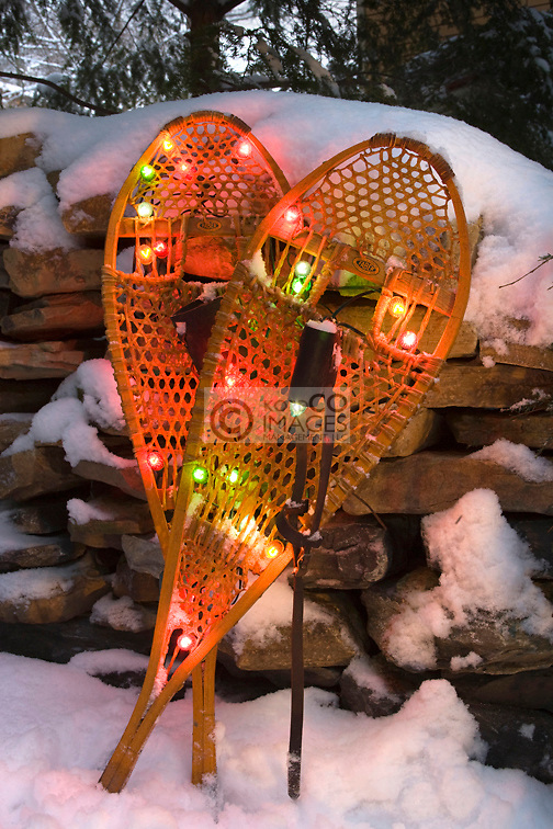 CHRISTMAS LIGHTS ON  SNOW COVERED SNOWSHOES IN SNOW