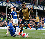 Alex Iwobi of Arsenal skip through the tackle made by Seamus Coleman of Everton during the Barclays Premier League match at The Goodison Park Stadium. Photo credit should read: Simon Bellis/Sportimage