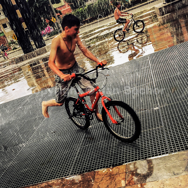 Colombian boys perform tricks on BMX bikes during the rain in Parque Chimeneas, Itagüí, Colombia, 19 November 2016.