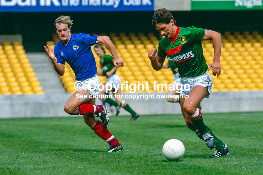 Jim Cowden, footballer, Glentoran FC, Belfast, N Ireland, UK, on the attack is shadowed by Lee Doherty, Linfield FC, Belfast (blue shirt). 19850811005..Copyright Image from Victor Patterson, 54 Dorchester Park, Belfast, UK, BT9 6RJ..Tel: +44 28 9066 1296.Mob: +44 7802 353836.Voicemail +44 20 8816 7153.Skype: victorpattersonbelfast.Email: victorpatterson@mac.com.Email: victorpatterson@ireland.com (back-up)..IMPORTANT: If you wish to use this image or any other of my images please go to www.victorpatterson.com and click on the Terms & Conditions. Then contact me by email or phone with the reference number(s) of the image(s) concerned.