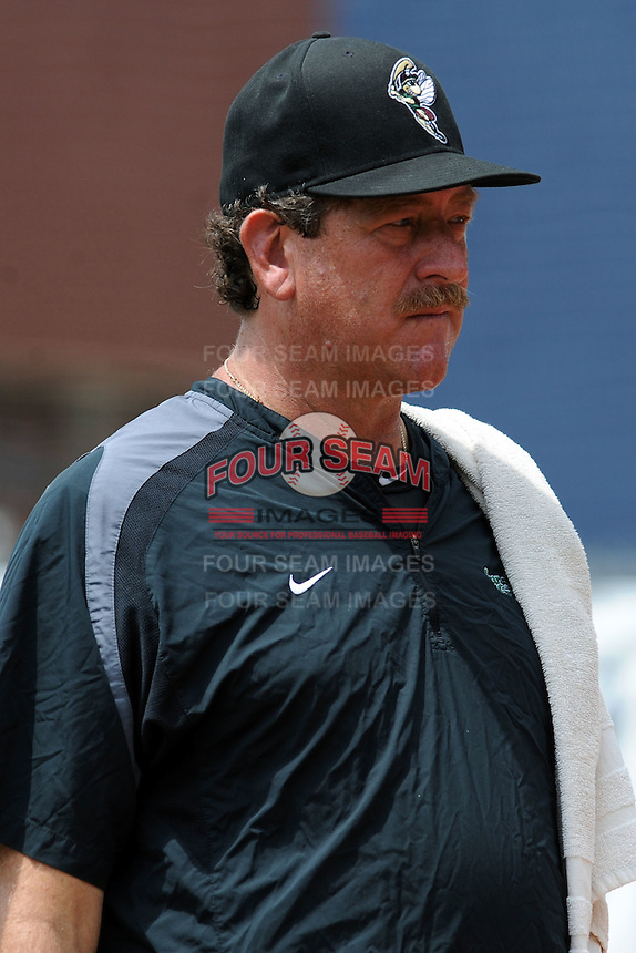 Savannah Sand Gnats pitching coach Frank Viola #16 before a game against the Asheville Tourists at McCormick Field on August 5, 2012 in Asheville, North Carolina. The Tourists defeated the Sand Gnats 5-4. (Tony Farlow/Four Seam Images).