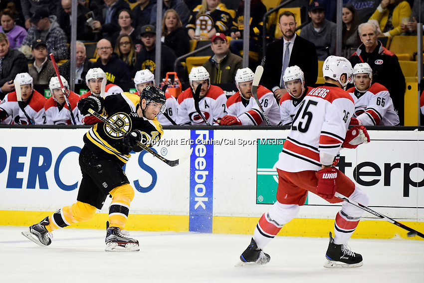 Thursday, December 1, 2016: Boston Bruins defenseman Joe Morrow (45) fires a shot by Carolina Hurricanes left wing Viktor Stalberg (25) during the National Hockey League game between the Carolina Hurricanes and the Boston Bruins held at TD Garden, in Boston, Mass. Eric Canha/CSM