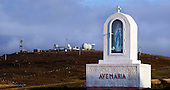 "War, and Peace, on Uist - Range Hebrides - looming over one of the islands' many religious icons, the Radar Tracking Station on the summit of Rueval, South Uist which hosts the radomes, masts, that are part of the ""rocket"" range, once run by the UK Armed Forces and now controlled by QinetiQ on behalf of the Ministry of Defence - Picture by Donald MacLeod 20.08.09"