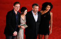"Il regista francese Luc Besson, secondo da destra, posa con la moglie e produttrice Virginie Besson-Silla, destra, l'attore inglese David Thewlis, sinistra, e l'attrice malese Michelle Yeoh, sul red carpet per la presentazione del suo nuovo film ""The Lady"", al Festival Internazionale del Film di Roma, 27 ottobre 2011..French director Luc Besson, second from right, poses with his wife and producer Virginie Besson-Silla, right, british actor David Thewlis, left, and malaysian actress Michelle Yeoh, on the red carpet to present his new movie ""The Lady"", during the international Rome Film Festival at Rome's Auditorium, 27 october 2011..UPDATE IMAGES PRESS/Riccardo De Luca"