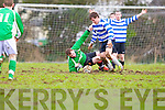 Stuck: John Kelly QPR and Stephen McCarthy Castleisland are side footed as the ball gets stuck in the mud during their league clash in Castleisland on Sunday