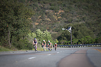 Rachel McBride, Meredith Kessler, Heather Wurtele and Heather Jackson climb the hills of Camp Pendleton in the Accenture Ironman California 70.3 in Oceanside, CA on March 29, 2014.