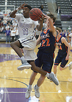 NWA Democrat-Gazette/ANDY SHUPE<br /> Frank Morgan (11) of Fayetteville leaps to score ahead of the reach of Dawson Peek of Heritage Tuesday, Feb. 13, 2018, during the first half of play in Bulldog Arena in Fayetteville. Visit nwadg.com/photos to see more photographs from the games.