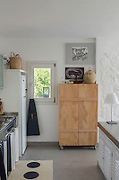 A 1970s kitchen forms part of the open plan living/dining area