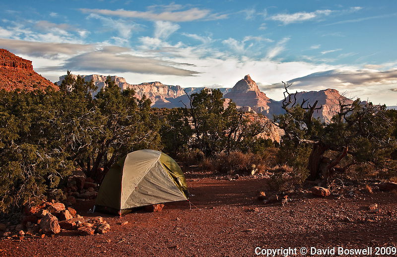 Camp at sunrise on Horseshoe Mesa, Grand Canyon National Park with Vishnu Temple visible in the background.