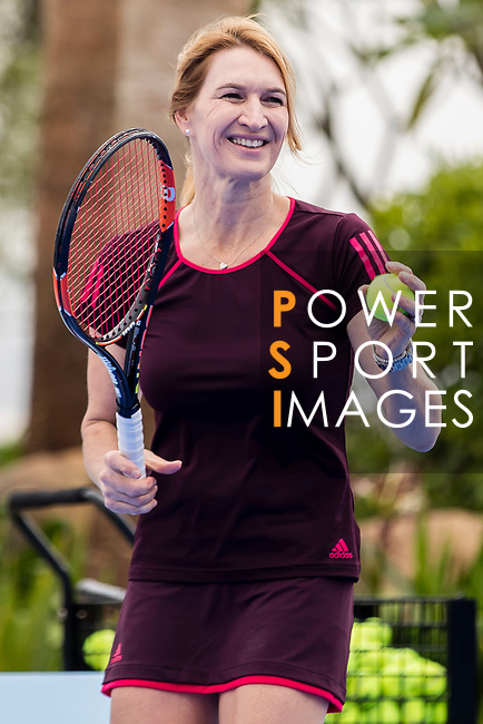 Steffi Graf of Germany, the global ambassador of Zhuhai WTA Elite Trophy 2017, plays with children during tennis clinic at plaza of Zhuhai International Convention and Exhibition Centre on November 04, 2017 in Zhuhai, China. Photo by Yu Chun Christopher Wong / Power Sport Images