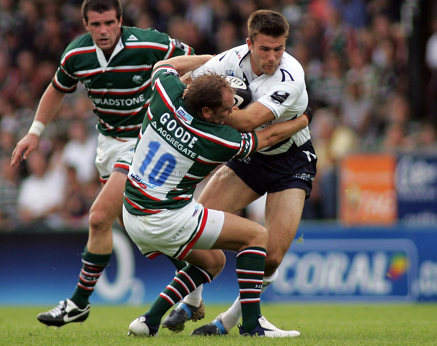 Photo: Paul Thomas..Leicester Tigers v Sale Sharks. Guinness Premiership. 03/09/2006...Sale's Chris Bell (R) gets tackled by Andy Goode.