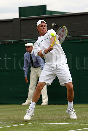 28 June 2006: Australian player Lleyton Hewitt (AUS) plays a double-handed backhand during his first round men's singles match against Volandri on the third day at the All England Lawn Tennis Championships, Wimbledon, London. Photo: Marc Morris/Actionplus...060628 man men