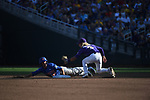OMAHA, NE - JUNE 26: Ryan Larson (66) of the University of Florida tries to avoid being tagged out at second base by Kramer Robertson (3) of Louisiana State University during the Division I Men's Baseball Championship held at TD Ameritrade Park on June 26, 2017 in Omaha, Nebraska. The University of Florida defeated Louisiana State University 4-3 in game one of the best of three series. (Photo by Justin Tafoya/NCAA Photos via Getty Images)