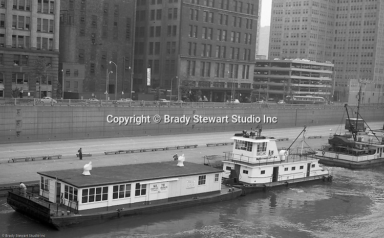 Pittsburgh PA:  Public Relations assignment for WW Patterson Company; a manufacturer of Towboat and Barge Winches - 1955. View of the new Campbell Barge Lines, Lady Jane. The Lady Jane is towing a US Army Corp of Engineers barge up the Allegheny River.  The Lady Jane was manufactured locally by Dravo for use in a contract for the Army Corp of Engineers.  The new towboat had all the new bells and whistles including state-of-the-art radar.