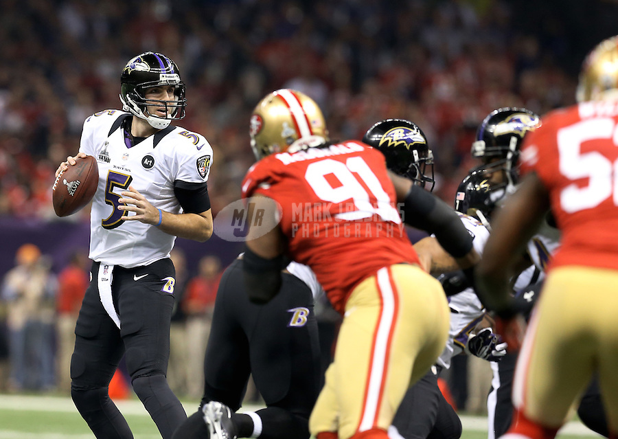 Feb 3, 2013; New Orleans, LA, USA; Baltimore Ravens quarterback Joe Flacco (5) drops back to pass against the San Francisco 49ers in the first quarter in Super Bowl XLVII at the Mercedes-Benz Superdome. Mandatory Credit: Mark J. Rebilas-