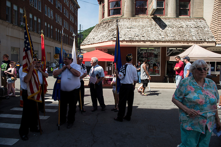 UNITED STATES - JULY 5: Rep. Nick Rahall, D-W.Va., speaks with American Legion members as the prepare for the presentation of the colors at the West Virginia Freedom Festival in downtown Logan, W. Va., on July 5, 2014. (Photo By Bill Clark/CQ Roll Call)
