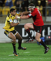 Julain Savea hands off Wyatt Crockett. Super 15 rugby match - Crusaders v Hurricanes at Westpac Stadium, Wellington, New Zealand on Saturday, 18 June 2011. Photo: Dave Lintott / lintottphoto.co.nz