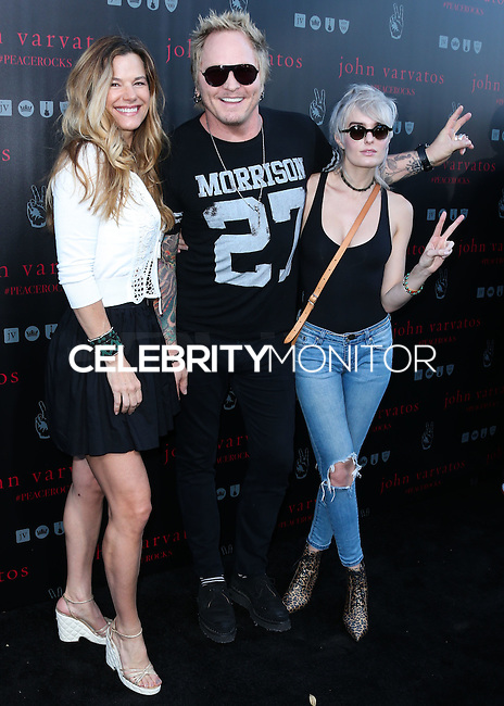 WEST HOLLYWOOD, CA, USA - SEPTEMBER 21: Matt Sorum, Ace Harper arrive at the John Varvatos #PeaceRocks Ringo Starr Private Concert held at the John Varvatos Boutique on September 21, 2014 in West Hollywood, California, United States. (Photo by Xavier Collin/Celebrity Monitor)