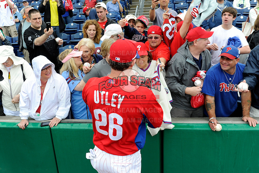 Philadelphia Phillies second baseman Chase Utley #26 signs autographs before a Spring Training game against the New York Yankees at Bright House Field on February 26, 2013 in Clearwater, Florida.  Philadelphia defeated New York 4-3.  (Mike Janes/Four Seam Images)