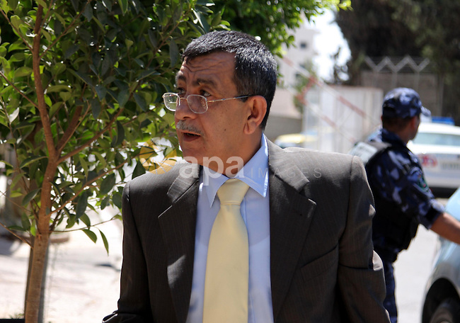 Palestinian Interior minister Said Abu Ali walk to attend the cabinet in the West Bank city of Ramallah on July 27, 2009. Photo by Issam Rimawi