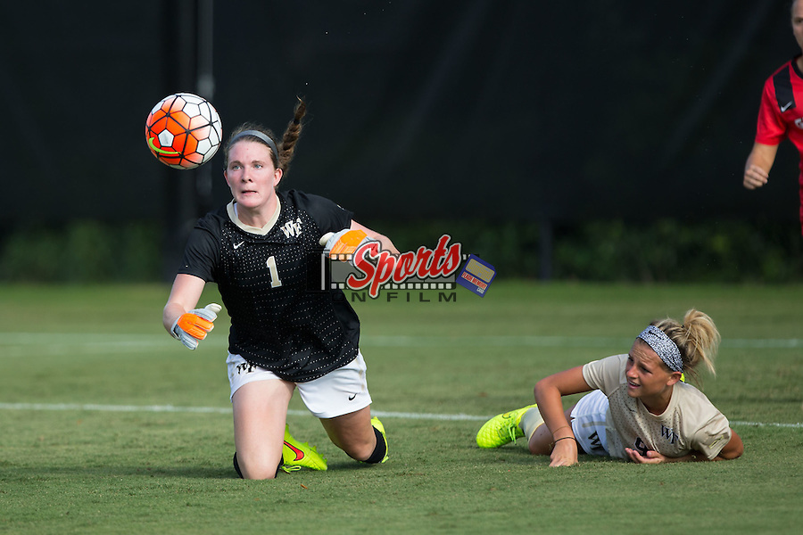 Lindsay Preston (1) of the Wake Forest Demon Deacons keeps her eye on the ball after colliding with teammate Bayley Feist (9) during second half action against the Georgia Bulldogs at Spry Soccer Stadium on August 23, 2015 in Winston-Salem, North Carolina.  The Deacons defeated the Bulldogs 4-0.  (Brian Westerholt/Sports On Film)