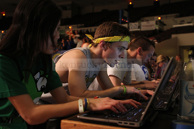 Senior Morale team members Annie Tiu, a biology major, and Parker Whitehouse, a second education history major, check their facebooks during DanceBlue, the 24 hour dance marathon, at Memorial Coliseum Saturday February 23th, 2013. Photo by Kirsten Holliday | Staff
