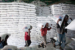 NAZARETH, ETHIOPIA - NOVEMBER 9 : Workers carry bags of wheat donated by the U.S government to WFP to distribute in Ethiopia on November 9, 2010 in central Nazareth, Ethiopia. Many trucks arrive every day from Djibouti and the grain is stored here in Nazareth for distribution around the country. (Photo by: Per-Anders Pettersson)