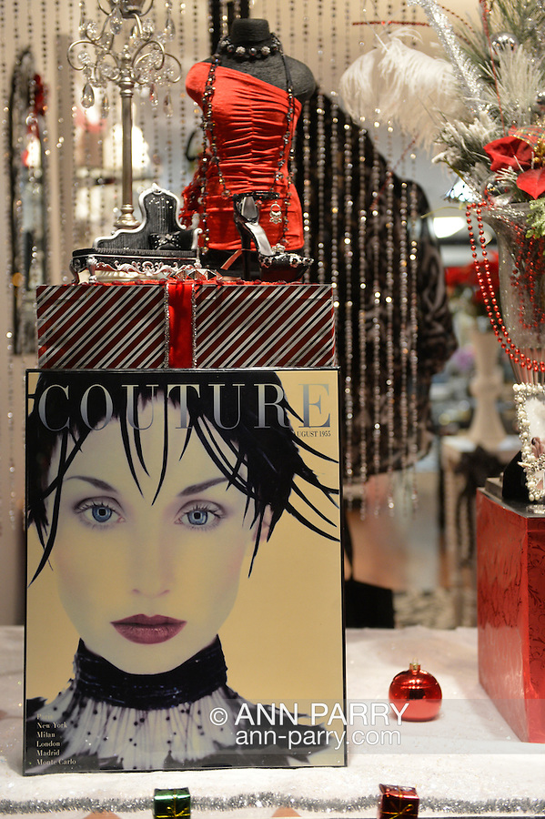 Nov. 23, 2012 - Merrick, New York, U.S. - All Dazzle, a women's fashion and accessory boutique on Long Island, has sales, and its front window is decorated, with Couture 1955 magazine cover art, in red, white, and black for the winter holidays.