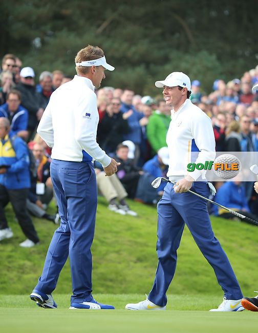 Ian Poulter celebrates with Rory McIlroy (EUR) during the Saturday morning Fourballs of the 2014 Ryder Cup at Gleneagles. The 40th Ryder Cup is being played over the PGA Centenary Course at The Gleneagles Hotel, Perthshire from 26th to 28th September 2014.: Picture Kenneth E.Dennis, www.golffile.ie: \27/09/2014\