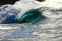 Beautiful backlit wave shot in the early afternoon at Waimea bay shorebreak on the North shore of Oahu, Hawaii.