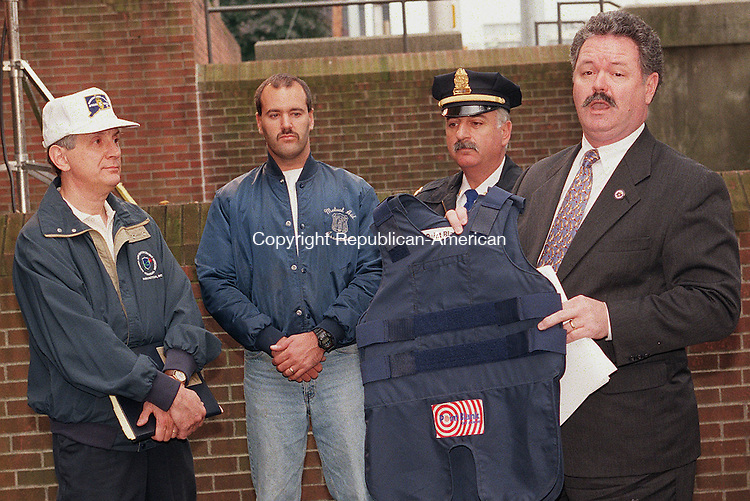 WATERBURY, CT 10/13/98--1013TK04.tif  (left to right:)Bill Wendling, Secretary for the Waterbury Council 15, Jeff Taylor, Treasure of Waterbury Council 15, Captain Dave Ceneviva of the Meriden Police Department and Gary Waterhouse, President of Council 15 declaring an endorsement for Congressman Jim Maloney. --TOM KABELKA staff photo for Terry Corcoran story.  (Filed in Scans/Scan-In)