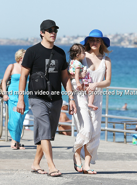 26 SEPTEMBER 2013 SYDNEY AUSTRALIA<br /> <br /> EXCLUSIVE PICTURES<br /> <br /> Jessica Marais pictured with her husband James and their first child Scout enjoying a walk along Bondi Corso.<br /> <br /> *No internet without clearance*.MUST CALL PRIOR TO USE +61 2 9211-1088. Matrix Media Group.Note: All editorial images subject to the following: For editorial use only. Additional clearance required for commercial, wireless, internet or promotional use.Images may not be altered or modified. Matrix Media Group makes no representations or warranties regarding names, trademarks or logos appearing in the images.