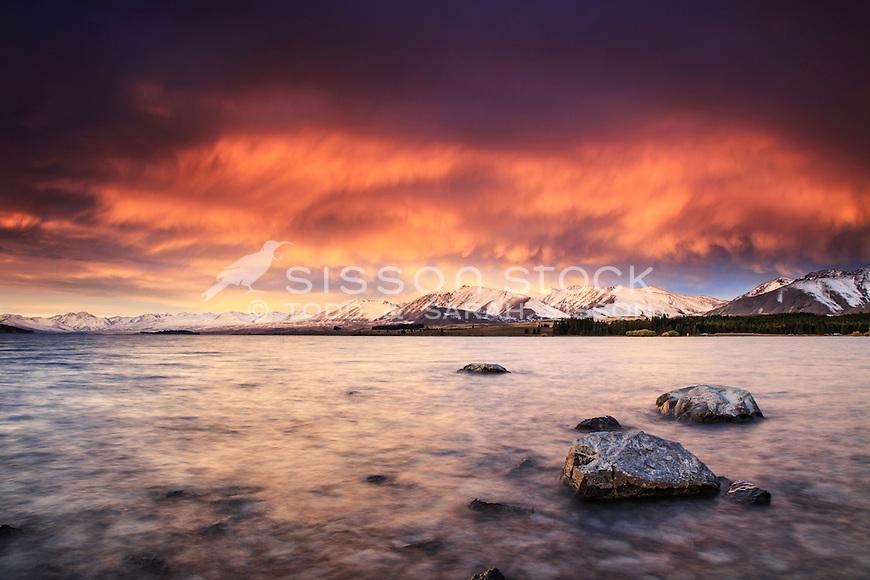 Spectacular sunset colours over Lake Tekapo and the Richmond Range.  South Canterbury New Zealand.