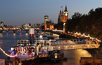 The Tattershall Castle, Victoria Embankment, London, UK, with The Palace of Westminster, Big Ben and Westminster bridge in the distance. The Tattershall Castle was built by W. Gray & Co. in 1934 and was a vital passenger link across the Humber estuary. Picture by Manuel Cohen