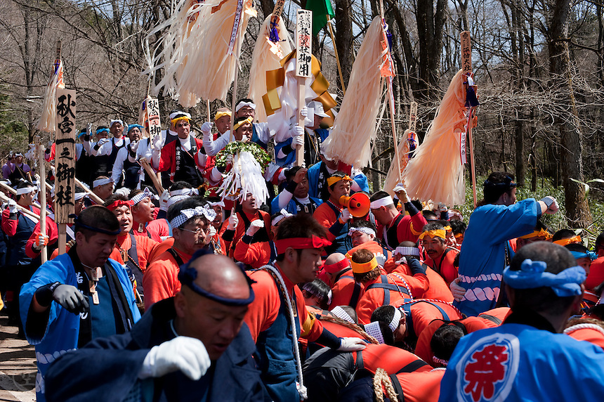 Yamadashi, or bringing the sacred pillars out of the mountains, during the Onbashira festival, where 16 sacred pillars are brought by hand to rejuvenate each the upper and lower Suwa Shrines in Nagano Prefecture.