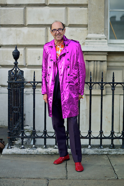 A man wears a purple Burberry Trench coat at London Fashion Week