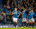 Martyn Waghorn thumps the Rangers badge to the Copland Road end after scoring his hat-trick of goals tonight