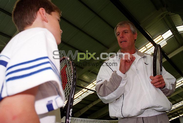 Pix: Simon Wilkinson/SWPIX. Patrice Hagelauer, Tennis Supremo...COPYWRIGHT PICTURE>>SIMON WILKINSON>>01943 436649>>..Tennis supremo Patrice Hagelauer puts a youngster through his paces.