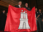 07 June 2006: United States head coach Bruce Arena (USA) (r) is presented with a Hamburg city flag by Hamburg mayor Ole von Beust (l). The United States Men's National Team was honored at City Hall, the Rathaus, in Hamburg, Germany, where the team is based out of for the FIFA 2006 World Cup tournament.