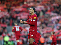 "30th November 2019; Anfield, Liverpool, Merseyside, England; English Premier League Football, Liverpool versus Brighton and Hove Albion; Virgil van Dijk of Liverpool looks toward the Kop as the Liverpool supporters sing ""You'll Never Walk Alone"" prior to the kick off  - Strictly Editorial Use Only. No use with unauthorized audio, video, data, fixture lists, club/league logos or 'live' services. Online in-match use limited to 120 images, no video emulation. No use in betting, games or single club/league/player publications"