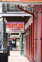 Strip clubs are shuttered on Bourbon Street during the coronavirus pandemic, Thurs., March 19, 2020.