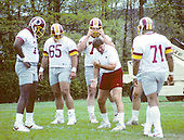 Washington Redskins offensive line coach Joe Bugel shows technique to some of his students during the 1988 Mini-Camp at Redskins Park in Herndon, Virginia on May 11, 1988.<br /> Credit: Arnold Sachs / CNP