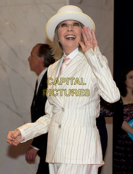 Diane Keaton.2012 White House Correspondents Association (WHCA) Annual Dinner held at the Washington Hilton Hotel, Washington, D.C., USA..April 28th, 2012.half length white hat pinstripe suit glasses smiling hand palm waving .CAP/ADM/RS.©Ron Sachs/CNP/AdMedia/Capital Pictures.