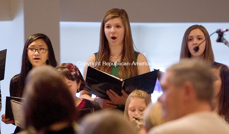 TORRINGTON CT. 15 December 2013-121513SV13-Members of the Sacred Heart Church Youth Choir perform during the Festival of Lessons and Carols at Sacred Heart Church in Southbury Sunday.<br /> Steven Valenti Republican-American