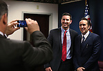 Nevada Assemblyman James Oscarson, R-Pahrump, takes a photo of Assemblyman Wes Duncan, R-Las Vegas, and actor Nicolas Cage at the Legislative Building Carson City, Nev., on Tuesday, May 7, 2013..Photo by Cathleen Allison