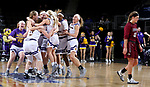 SIOUX FALLS, SD: MARCH 7: The Western Illinois Leathernecks celebrate their 77-69 overtime win as Caitlyn Tolen #12 from IUPUI walks off the court at the Women's Summit League Basketball Championship Game on March 7, 2017 at the Denny Sanford Premier Center in Sioux Falls, SD. (Photo by Dave Eggen/Inertia)