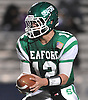 Andrew Cain #12, Seaford quarterback, gets ready to hand off during the Nassau County varsity football Conference IV final against Carle Place-Wheatley at Hofstra University on Saturday, Nov. 19, 2016. Seaford won by a score of 20-0.