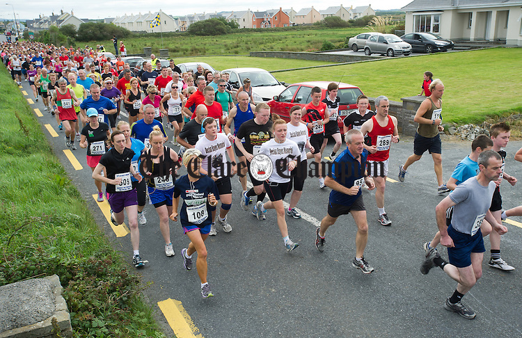 The huge entry of runners and walkers set off on the Declan Hayes Memorial Doonbeg Half Marathon/10K Fun Run and Walk. Photograph by John Kelly.